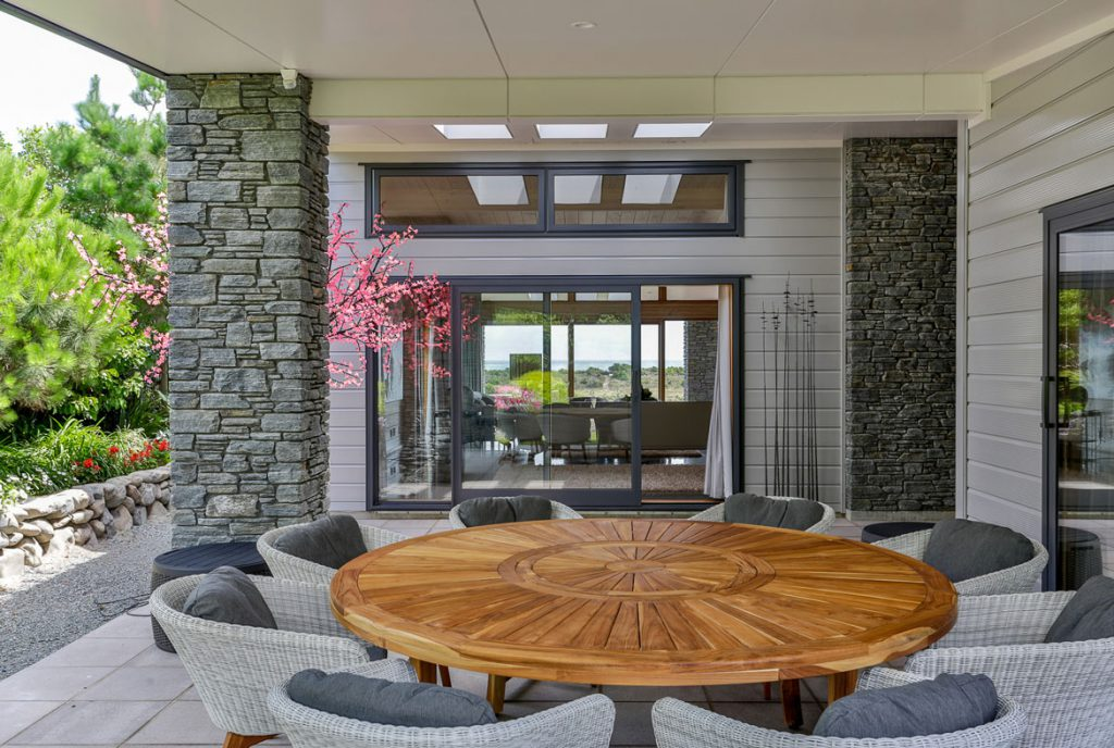 Outdoor entertainment area with high clerestories