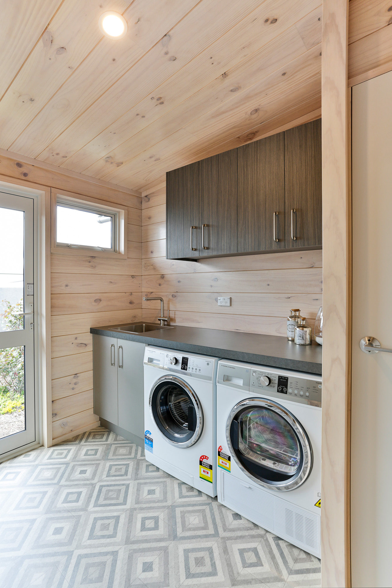 Lockwood home laundry with grey cement look formica benchtop