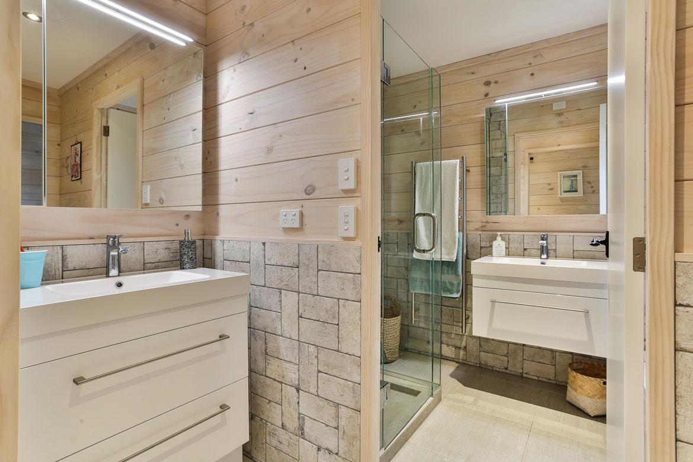 Lockwood home bathroom with grey wall tiles