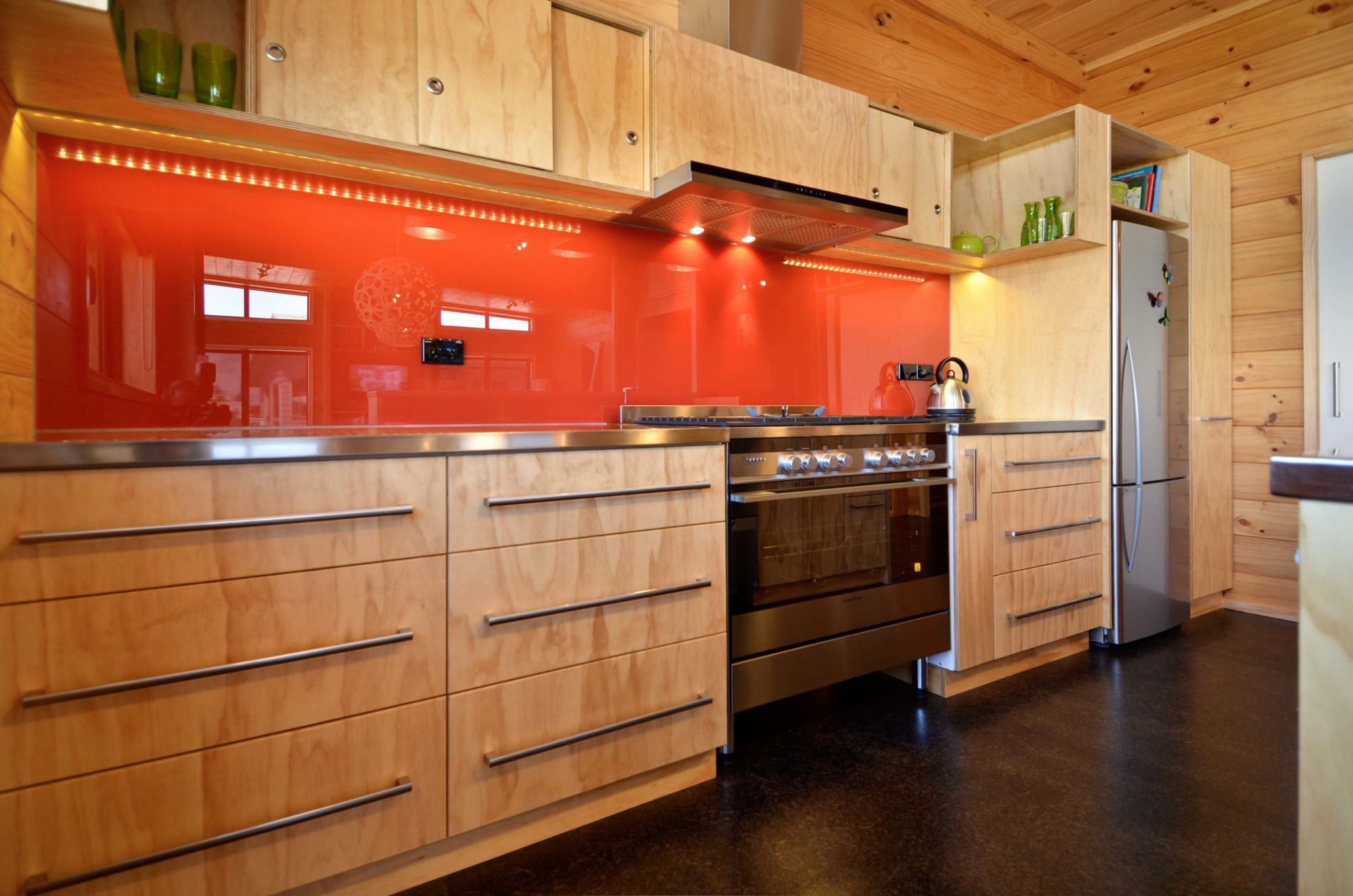 Kitchen with orange splash back