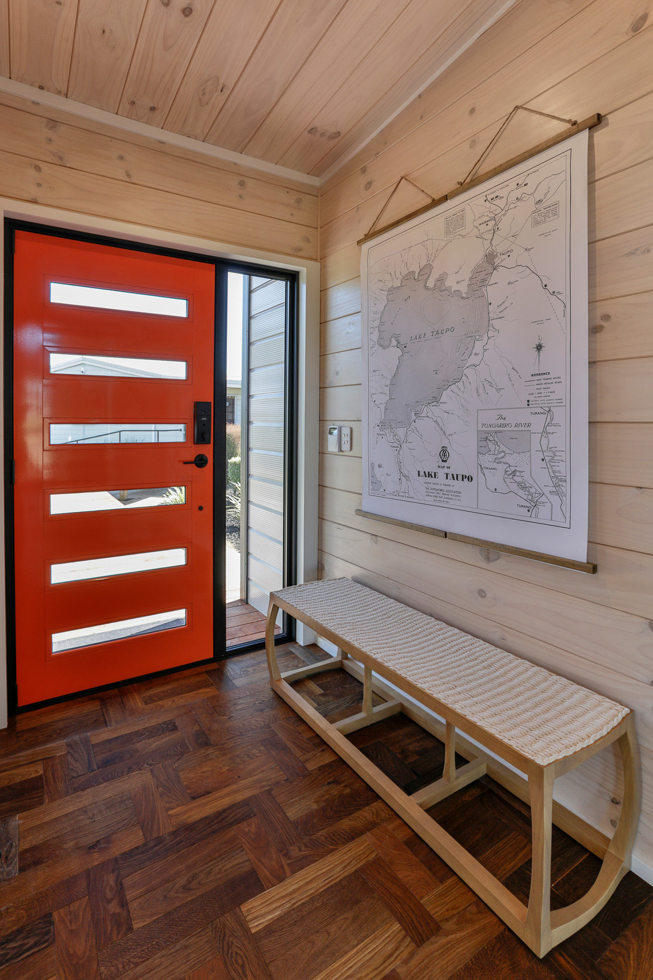 Lockwood Taupo Show Home Orange front door with black joinery