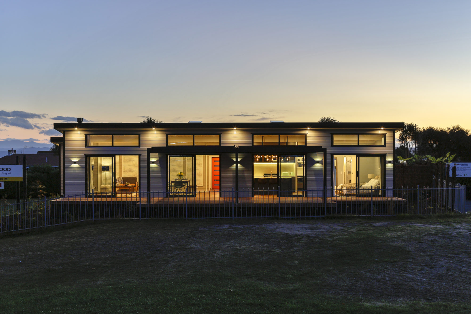 Lockwood Taupo with Textura Black joinery and white cladding