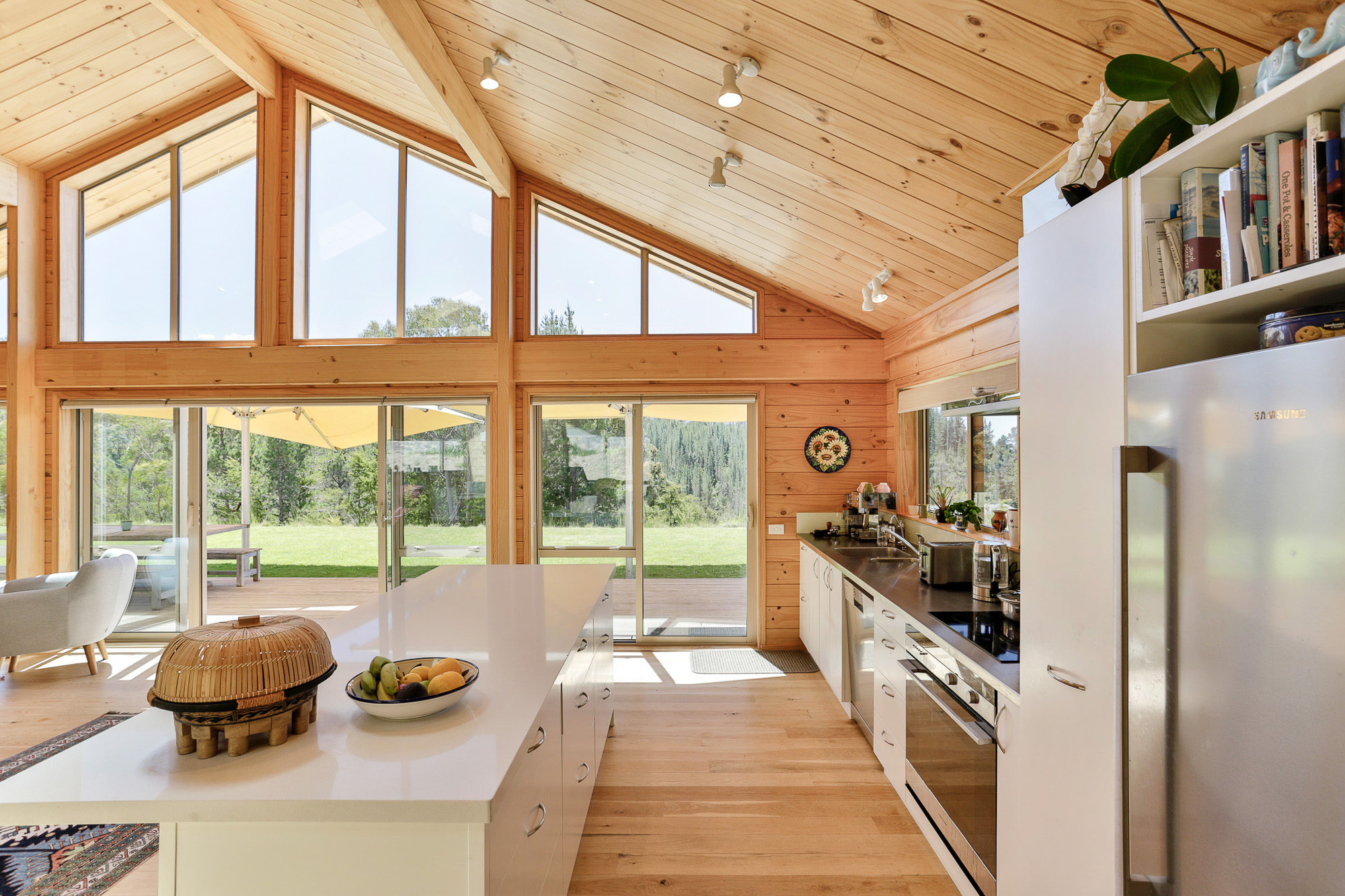 Lockwood Kaiteriteri home with timber portals and large gabled windows