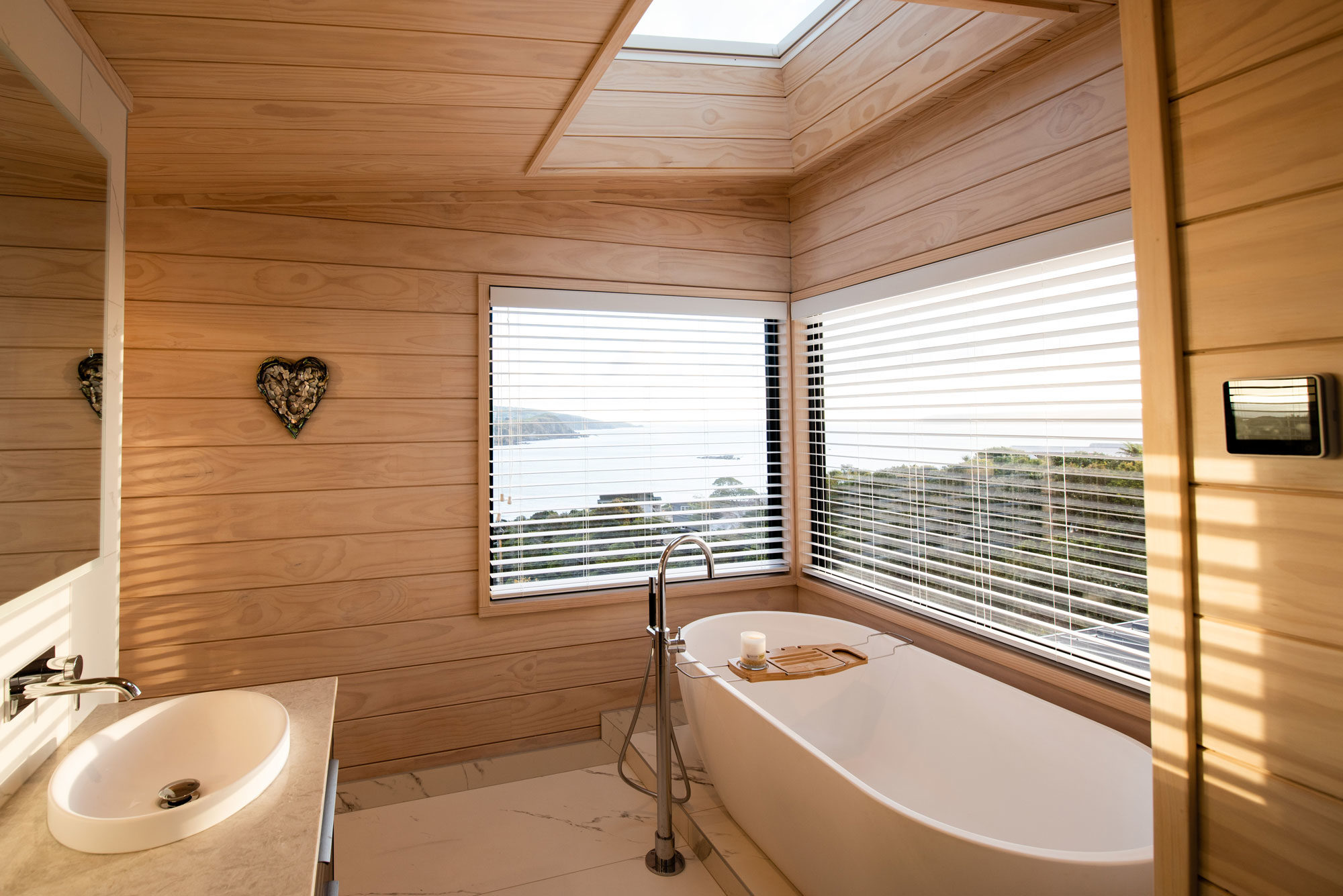 Stand alone bath in a Lockwood home with skylight and amazing views