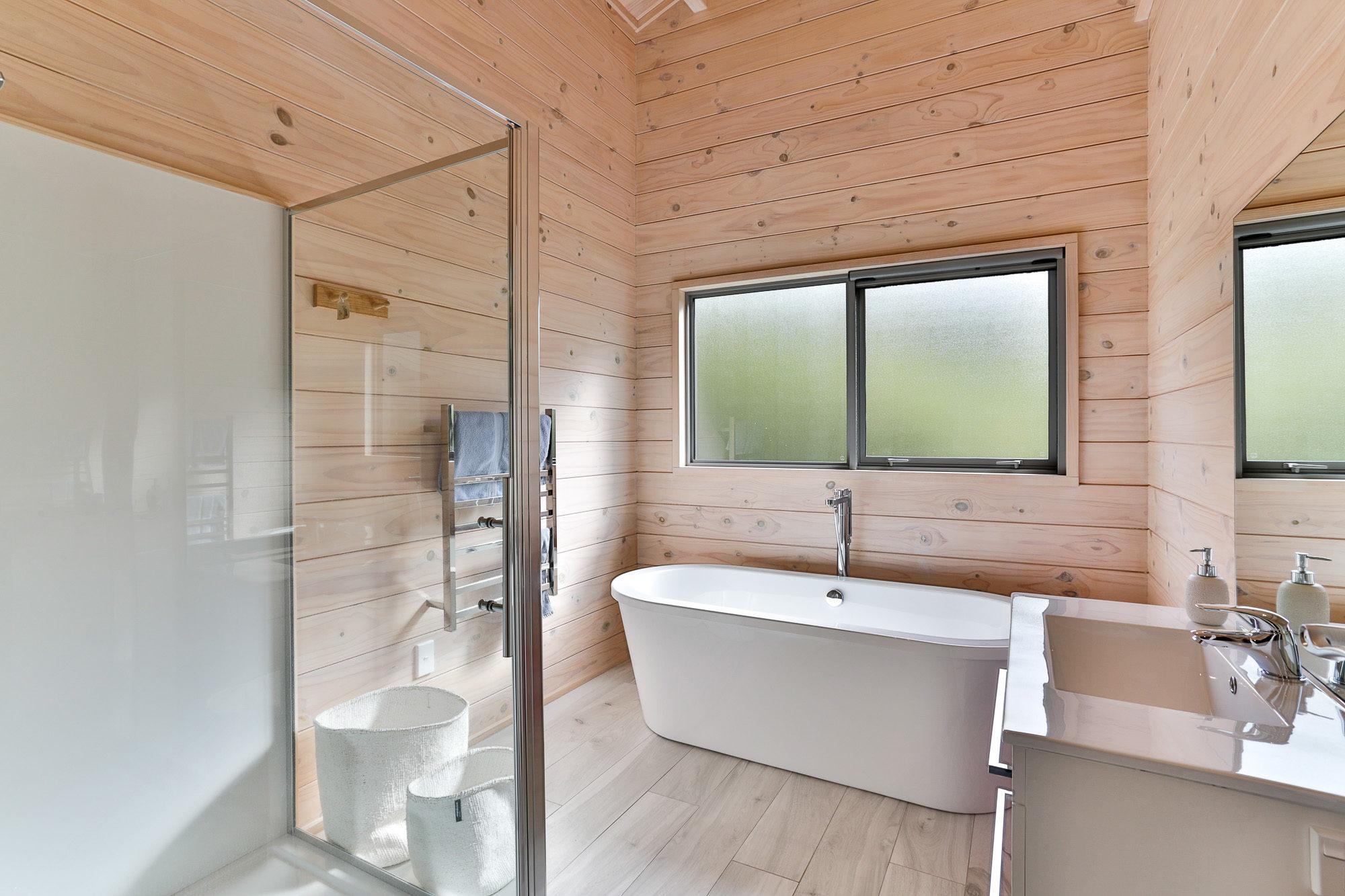 Back to wall bath in Lockwood home at Lake Tarawera