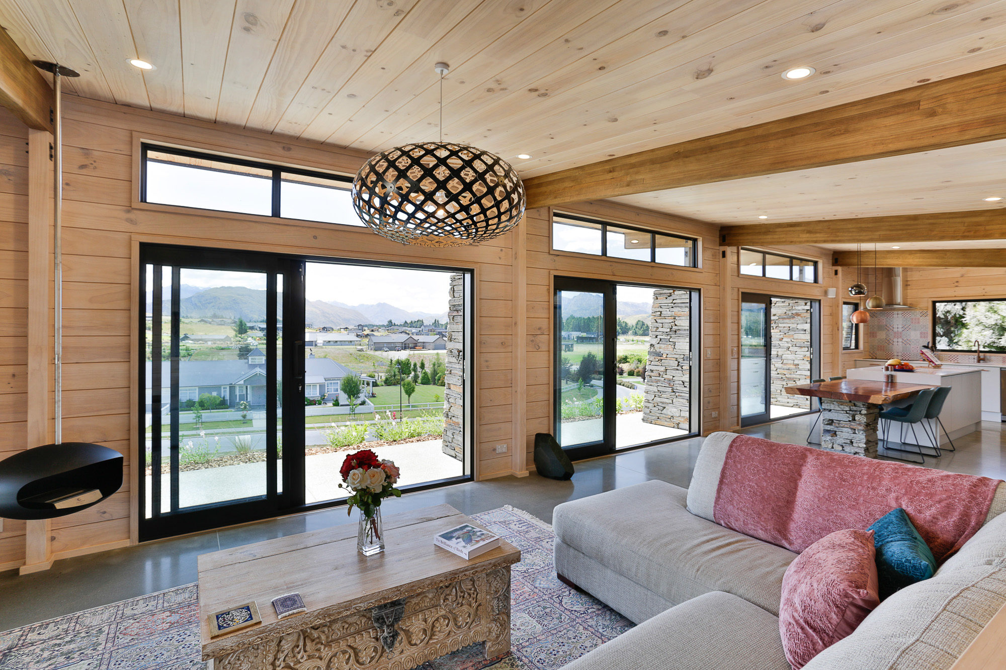 Large sliding doors frame the amazing view