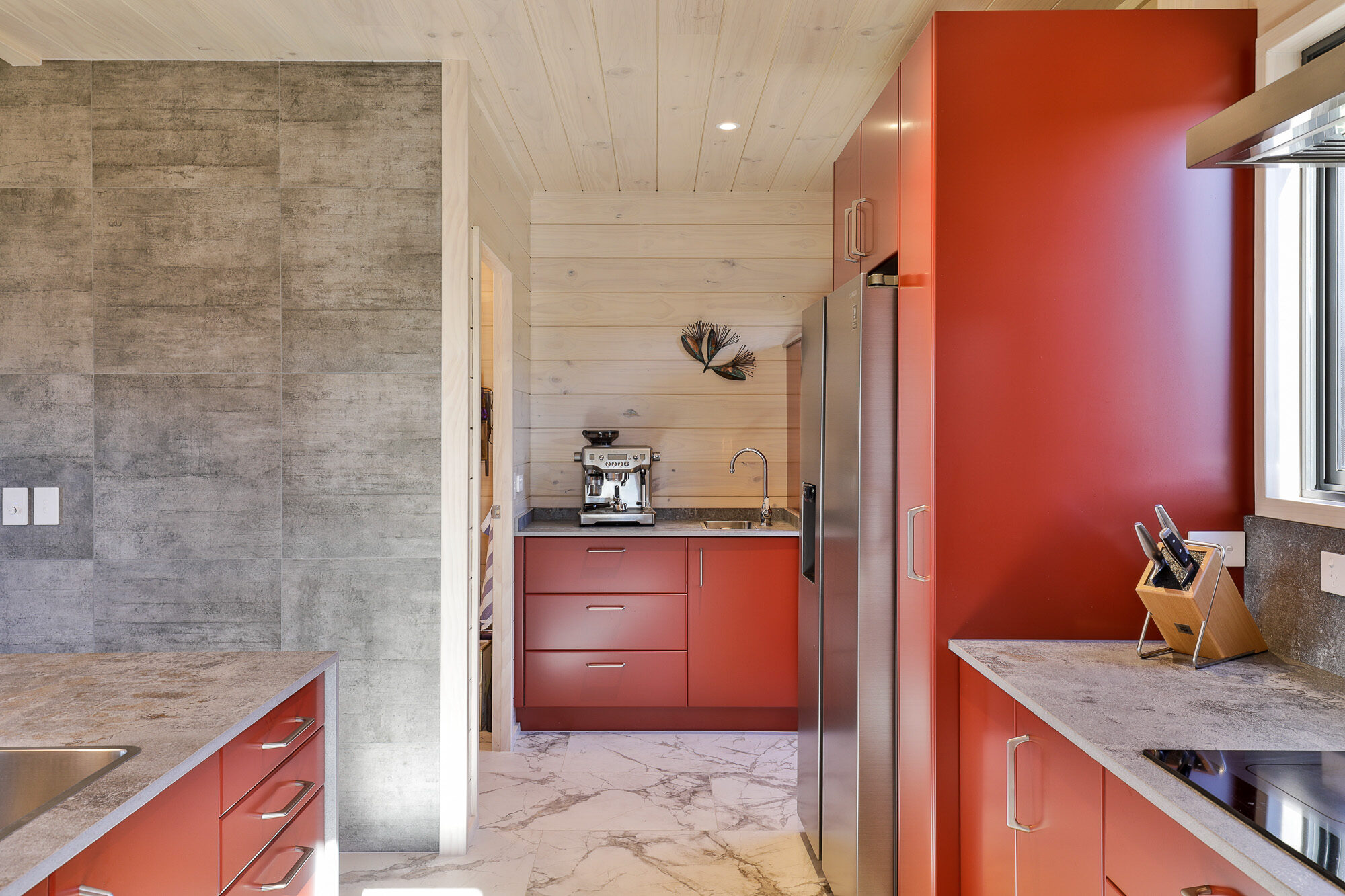 Coloured joinery adds pop of colour to Lockwood home