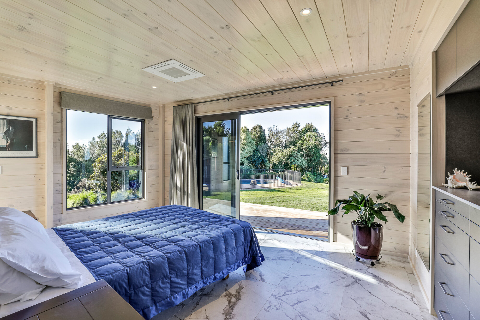 Naturally lit Lockwood room with deck access